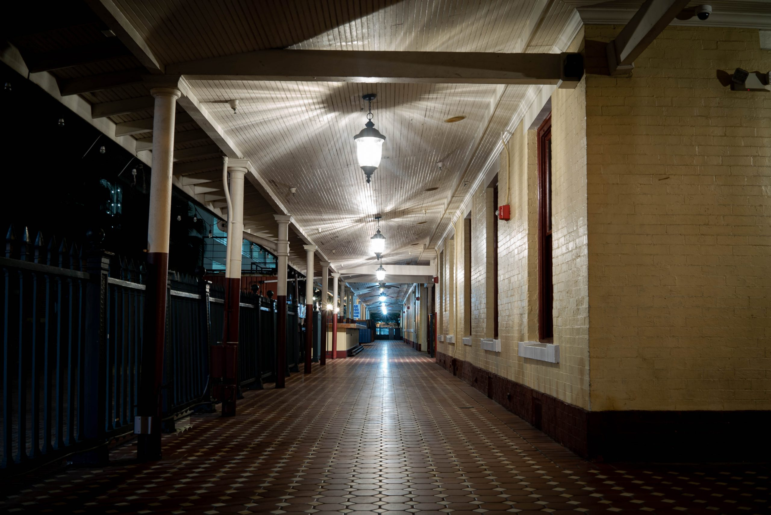 A night time photograph looking down a tiled station platform, the creepy lights make star patterns on the ceiling, they don't illuminate the ghosts that haunt Orlando Old station