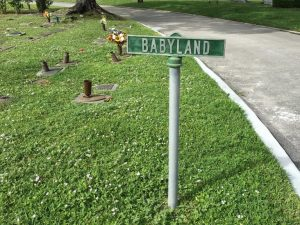 """A small sign reads """"baby land"""""""