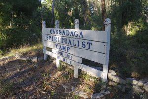 "Signage that reads ""Cassadaga Spiritualist Camp"" at the entrance of the Spiritualist community."